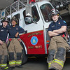 "UAF student firefighters/EMTs John McGee, left, Lillian Hampton and Ethan Stevenson pose by one of the firetrucks housed in the Whitaker Building on the Fairbanks campus.  <div class=""ss-paypal-button"">Filename: AAR-11-3223-108.jpg</div><div class=""ss-paypal-button-end"" style=""""></div>"