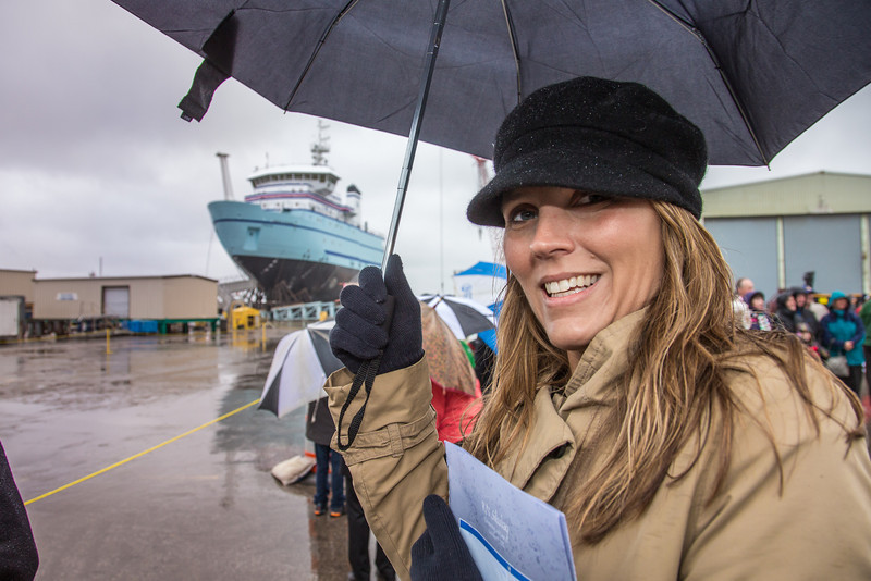 """Michelle Renfrew arrives at the shipyard in a driving rain to witness the launch of the R/V Sikuliaq at Marinette Marine Corp. in Marinette, Wisc.  <div class=""""ss-paypal-button"""">Filename: AAR-12-3594-001.jpg</div><div class=""""ss-paypal-button-end"""" style=""""""""></div>"""