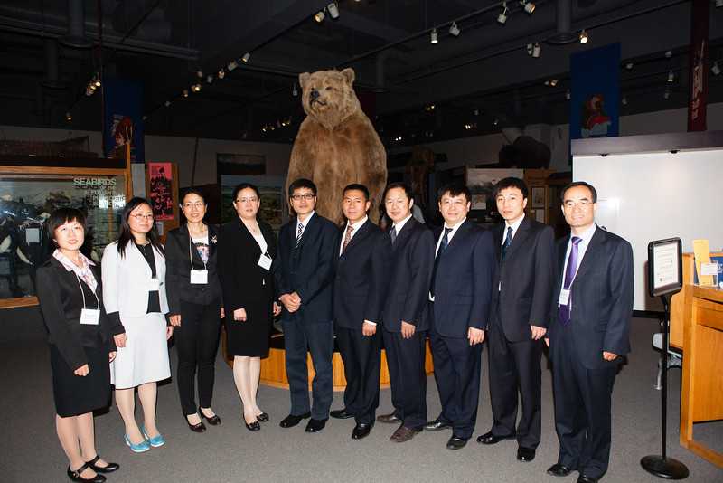 """SOM's Academic Leadership Institute participants pose for a photo inside the Museum of the North.  <div class=""""ss-paypal-button"""">Filename: AAR-12-3455-13.jpg</div><div class=""""ss-paypal-button-end"""" style=""""""""></div>"""