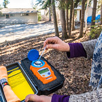 Jan Dawe, an instructor with OneTree Alaska, checks the sugar content from a batch of birch sap collected from a tree near the Chancellor's House on the Fairbanks campus. OneTree Alaska is a ...
