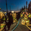 "Student fire fighter Crosby Hanson, right, dons his mask along with other members of the University Fire Department before entering a burning building as part of a live training drill at the Fairbanks Fire Training Center.  <div class=""ss-paypal-button"">Filename: AAR-13-3978-35.jpg</div><div class=""ss-paypal-button-end"" style=""""></div>"