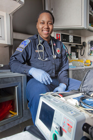 UAF student firefighter/EMT Lillian Hampton pauses during a training exercise in the back of an ambulance housed in the Whitaker Building on the Fairbanks campus.  Filename: AAR-11-3223-46.jpg