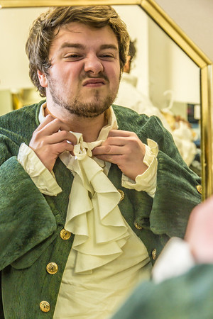 "Brian Tuohy, playing the title role in Theatre UAF's production of ""Tartuffe,"" gets into his costume before performing a live teaser in Wood Center a couple of days before opening night.  Filename: AAR-14-4121-5.jpg"