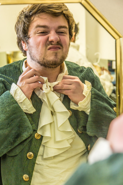 "Brian Tuohy, playing the title role in Theatre UAF's production of ""Tartuffe,"" gets into his costume before performing a live teaser in Wood Center a couple of days before opening night.  <div class=""ss-paypal-button"">Filename: AAR-14-4121-5.jpg</div><div class=""ss-paypal-button-end"" style=""""></div>"