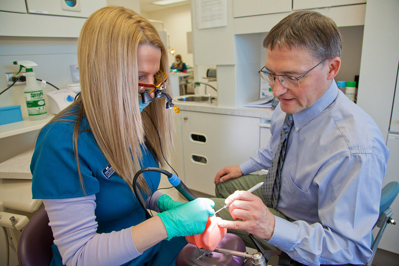 "Program director Vaughan Hoefler works with one of his students in CTC's dental hygienist program in their training facility in downtown Fairbanks.  <div class=""ss-paypal-button"">Filename: AAR-12-3308-042.jpg</div><div class=""ss-paypal-button-end"" style=""""></div>"