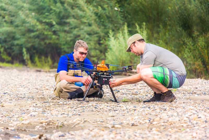 """Jimmy Fox, deputy field supervisor for the U.S. Fish and Wildlife Service, works with Carl France, contractor with the Alaska Center for Unmanned Aircraft Systems Integration (ACUASI) on a gravel bar on the upper Chena River on July 31. Fox is working with ACUASI to capture video footage of prime king salmon habitat on the Chena to increase public awareness.  <div class=""""ss-paypal-button"""">Filename: AAR-15-4593-327.jpg</div><div class=""""ss-paypal-button-end""""></div>"""