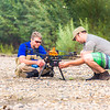"Jimmy Fox, deputy field supervisor for the U.S. Fish and Wildlife Service, works with Carl France, contractor with the Alaska Center for Unmanned Aircraft Systems Integration (ACUASI) on a gravel bar on the upper Chena River on July 31. Fox is working with ACUASI to capture video footage of prime king salmon habitat on the Chena to increase public awareness.  <div class=""ss-paypal-button"">Filename: AAR-15-4593-327.jpg</div><div class=""ss-paypal-button-end""></div>"