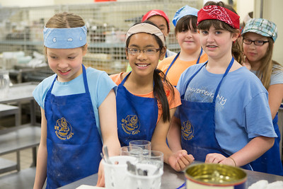 Students from Summer Sessions' Café Tween pose for a photograph after cooking Italian cuisine at Hutchinson's kitchen.  Filename: AAR-12-3432-5.jpg