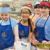 "Students from Summer Sessions' Café Tween pose for a photograph after cooking Italian cuisine at Hutchinson's kitchen.  <div class=""ss-paypal-button"">Filename: AAR-12-3432-5.jpg</div><div class=""ss-paypal-button-end"" style=""""></div>"