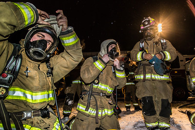 UFD student firefighters don their gear before tackling a live blaze during a drill at the Fairbanks International Airport.  Filename: AAR-13-3995-140.jpg