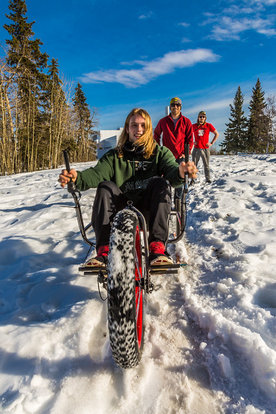 """Mechanical engineering major Daniel Sandstrom operates a fat tire ski bike he and partners Neil Gotschall, left, and Eric Bookless designed and built for paraplegic users as their spring 2016 senior design project. The bike is powered by pushing and pulling on the handles.  <div class=""""ss-paypal-button"""">Filename: AAR-16-4856-63.jpg</div><div class=""""ss-paypal-button-end""""></div>"""