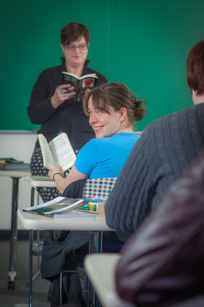 """Senior foreign languages major Lindsey Miller reads along with Professor Alexandra Fitts in her Hispanic Theater class during a recent meeting in the Gruening Building.  <div class=""""ss-paypal-button"""">Filename: AAR-12-3350-28.jpg</div><div class=""""ss-paypal-button-end"""" style=""""""""></div>"""