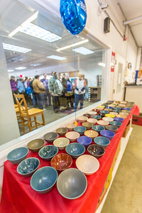 Members of the public line up outside the warehouse at the Fairbanks Community Food Bank for a chance to buy bowls made by local potters. Among those contributing was UAF art major Ian Wilkinson, who made 1,200 individual bowls as part of his senior thesis, sold them all in about 30 minutes, and donated $18,000 to the local charity.  Filename: AAR-13-3790-14.jpg