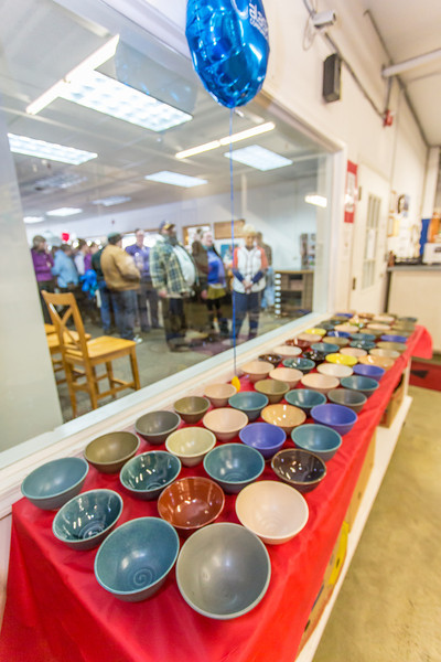 "Members of the public line up outside the warehouse at the Fairbanks Community Food Bank for a chance to buy bowls made by local potters. Among those contributing was UAF art major Ian Wilkinson, who made 1,200 individual bowls as part of his senior thesis, sold them all in about 30 minutes, and donated $18,000 to the local charity.  <div class=""ss-paypal-button"">Filename: AAR-13-3790-14.jpg</div><div class=""ss-paypal-button-end"" style=""""></div>"