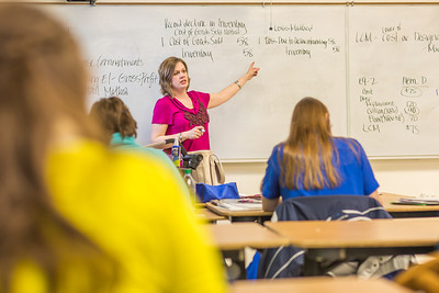 Amy Cooper lectures to her intermediate accounting students in a Duckering Building classroom.  Filename: AAR-14-4112-129.jpg