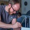 "Program lab assistant Joel Sturm reloads one of the printers during an open work session in UAF's Community and Technical College's 3-D print lab in downtown Fairbanks.  <div class=""ss-paypal-button"">Filename: AAR-16-4857-061.jpg</div><div class=""ss-paypal-button-end""></div>"