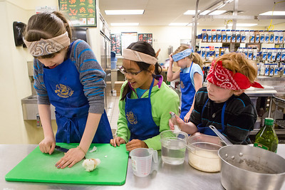 Café Tween students receive hands on training in the culinary arts as they prepare Indian style cuisine at the Community and Technical College's kitchen.  Filename: AAR-12-3434-14.jpg