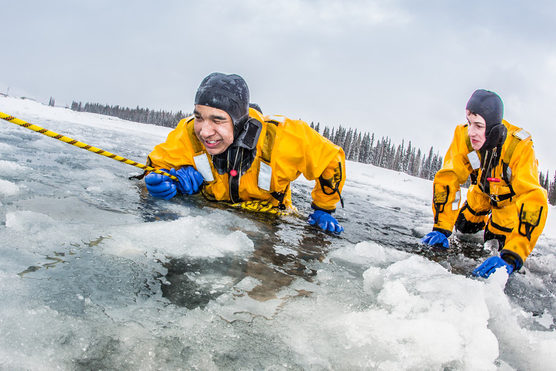 """Jordan Sanchez, left, and Joshua Stern practice cold-water rescue techniques this morning with the University of Alaska Fairbanks Fire Department.  <div class=""""ss-paypal-button"""">Filename: AAR-13-3797-38.jpg</div><div class=""""ss-paypal-button-end"""" style=""""""""></div>"""