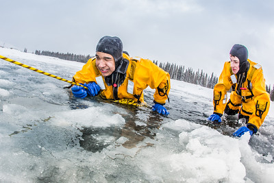 Jordan Sanchez, left, and Joshua Stern practice cold-water rescue techniques this morning with the University of Alaska Fairbanks Fire Department.  Filename: AAR-13-3797-38.jpg