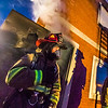 "UFD Captain Ben Fleagle exits a burning building during a live training drill at the Fairbanks Fire Training Center in South Fairbanks. McClean was helping lead the session with about 30 students participating  department's Tuesday night drill Oct. 22.  <div class=""ss-paypal-button"">Filename: AAR-13-3978-140.jpg</div><div class=""ss-paypal-button-end"" style=""""></div>"