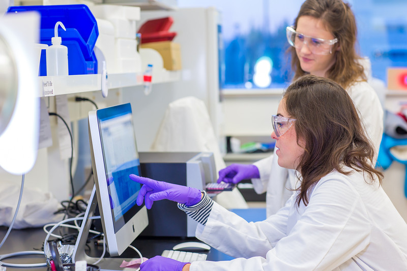 """Undergraduate Alyssa Komac, right, and graduate student Theresia Schnurr study the data they're getting in their research involving the metabolism in Alaska sled dogs.  <div class=""""ss-paypal-button"""">Filename: AAR-12-3673-87.jpg</div><div class=""""ss-paypal-button-end"""" style=""""""""></div>"""
