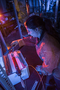 Volcanology graduate student Rebecca deGraffenreid removes a rod containing volcanic remnants from a furnace in the Reichardt Building petrology lab.
