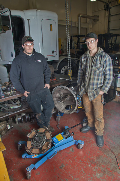 """Tony Craig, left, and George Jensen work together disassembling a transmission in the diesel mechanics lab at the Hutchison Institute of Technology.  <div class=""""ss-paypal-button"""">Filename: AAR-12-3312-104.jpg</div><div class=""""ss-paypal-button-end"""" style=""""""""></div>"""