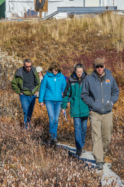"""Brett Biebuyck, assistant operations supervisor at UAF's Toolik Field Station, and Donie Bret-Harte, Toolik's associate science director, lead U.S. Senator Lisa Murkowski and other UAF visitors on a tour of the unique research center, located about 330 miles north of Fairbanks on Alaska's North Slope.  <div class=""""ss-paypal-button"""">Filename: AAR-13-3929-306.jpg</div><div class=""""ss-paypal-button-end""""></div>"""