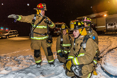 UFD Captain Forrest Kuiper, left, gives instructions to students during a live drill at the Fairbanks International Airport.  Filename: AAR-13-3995-32.jpg