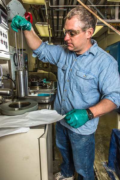 "Research professional Matt Bray studies pressurized petroleum samples in a Duckering Building rock mechanics lab.  <div class=""ss-paypal-button"">Filename: AAR-13-3919-43.jpg</div><div class=""ss-paypal-button-end"" style=""""></div>"