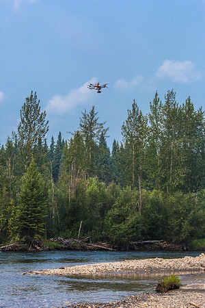An unmanned aerial vehicle (UAV) stands ready to collect video of important king salmon spawning habitat along a popular stretch of the upper Chena River about 40 miles northeast of Fairbanks. The project was a collaboration between the Alaska Center for Unmanned Aircraft Systems Integration (ACUASI) and the U.S. Fish and Wildlife Service.  Filename: AAR-15-4593-246.jpg
