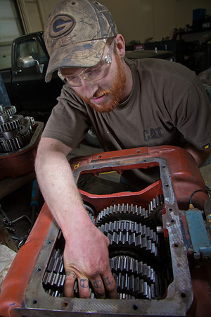 Seth Philbert works on a project in the diesel mechanics lab at the Hutchison Institute of Technology.  Filename: AAR-12-3312-152.jpg