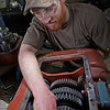 """Seth Philbert works on a project in the diesel mechanics lab at the Hutchison Institute of Technology.  <div class=""""ss-paypal-button"""">Filename: AAR-12-3312-152.jpg</div><div class=""""ss-paypal-button-end"""" style=""""""""></div>"""