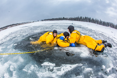 Student firefighters practice cold-water rescue techniques at a pond near the Fairbanks campus.  Filename: AAR-13-3797-24.jpg