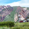 """Paul Layer, dean of UAF's College of Natural Sciences and Mathematics, left, and research assistant professor Jeff Benowitz, rest along the trail on a hike up Tattler Creek in Denali National Park. The area has drawn intense interest in recent years after several discoveries of dinosaur remains along the drainage.  <div class=""""ss-paypal-button"""">Filename: AAR-13-3899-486.jpg</div><div class=""""ss-paypal-button-end"""" style=""""""""></div>"""