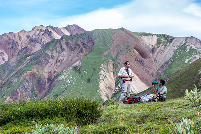 Paul Layer, dean of UAF's College of Natural Sciences and Mathematics, left, and research assistant professor Jeff Benowitz, rest along the trail on a hike up Tattler Creek in Denali National Park. The area has drawn intense interest in recent years after several discoveries of dinosaur remains along the drainage.  Filename: AAR-13-3899-486.jpg