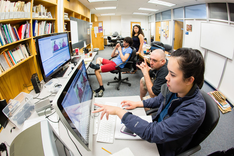 """Jennifer Martelle and Jeremiah Harrington edit footage for a documentary feature on the """"riot-resistant"""" Gruening Building at MAYmester's Hands on Documentary Production class.  <div class=""""ss-paypal-button"""">Filename: AAR-12-3421-19.jpg</div><div class=""""ss-paypal-button-end"""" style=""""""""></div>"""