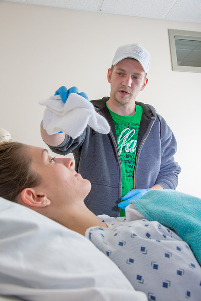 "Michael Lanz administers a faux sponge bath to fellow student Danielle Austin during an exercise in their nurse aide training program at UAF's Community and Technical College.  <div class=""ss-paypal-button"">Filename: AAR-12-3548-026.jpg</div><div class=""ss-paypal-button-end"" style=""""></div>"