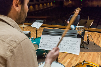 Students work with Professor Morris Palter during class, MUS F606 - Advanced Chamber Music - Percussion, in the Davis Concert Hall.  Filename: AAR-14-4094-14.jpg