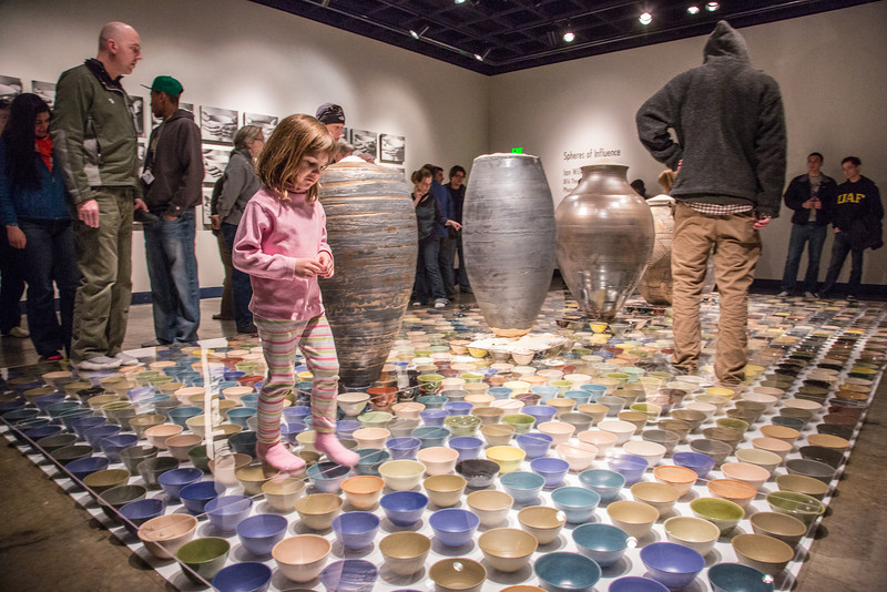 """Patrons of all ages walked around on the ceramic artwork produced by Ian Wilkinson for his BFA thesis during the opening of his show in the gallery in the UAF Fine Arts Complex.  <div class=""""ss-paypal-button"""">Filename: AAR-13-3780-344.jpg</div><div class=""""ss-paypal-button-end"""" style=""""""""></div>"""