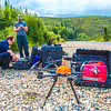 "Trevor Parcell, left, and Carl France with the Alaska Center for Unmanned Aircraft Systems Integration (ACUASI) set up a piloting station on a gravel bar along the upper Chena River. The UAV pilots were taking part in a joint effort with the U.S. Fish and Wildlife Service to collect video of important king salmon spawning habitat.  <div class=""ss-paypal-button"">Filename: AAR-15-4593-074.jpg</div><div class=""ss-paypal-button-end""></div>"