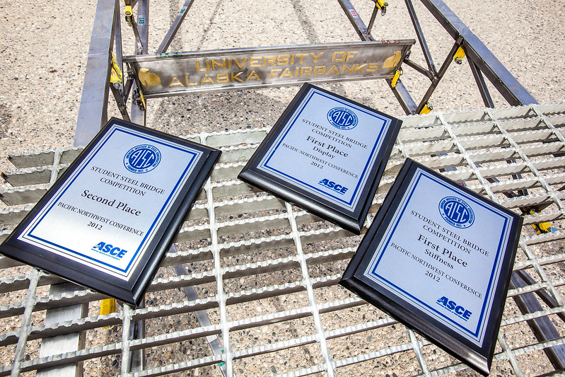 "UAF's entry into the regional steel bridge competition placed well, as verified by these plaques.  <div class=""ss-paypal-button"">Filename: AAR-12-3388-60.jpg</div><div class=""ss-paypal-button-end"" style=""""></div>"