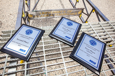 UAF's entry into the regional steel bridge competition placed well, as verified by these plaques.  Filename: AAR-12-3388-60.jpg