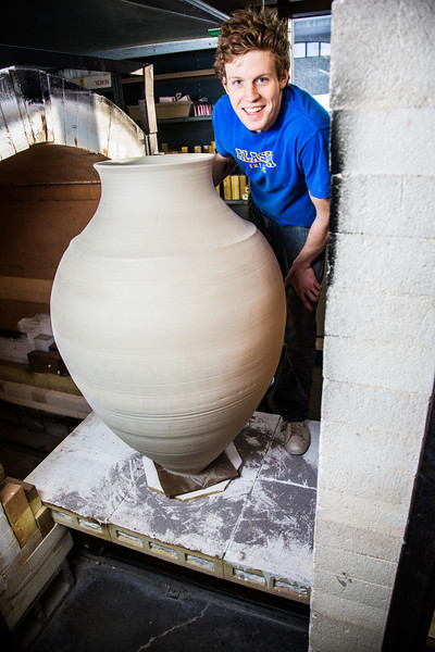 """Art major Ian Wilkinson removes one of his giant ceramic vessels he made as for his senior thesis from a kiln in the UAF ceramics studio.  <div class=""""ss-paypal-button"""">Filename: AAR-13-3744-34.jpg</div><div class=""""ss-paypal-button-end"""" style=""""""""></div>"""