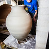 "Art major Ian Wilkinson removes one of his giant ceramic vessels he made as for his senior thesis from a kiln in the UAF ceramics studio.  <div class=""ss-paypal-button"">Filename: AAR-13-3744-34.jpg</div><div class=""ss-paypal-button-end"" style=""""></div>"