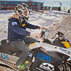 "Engineering major Isaac Thompson drives the electric snowmachine he and other members of his team helped modify into the Duckering Building after its return to campus after claiming the top prize in the SAE Clean Showmobile Challenge in Houghton, Mich.  <div class=""ss-paypal-button"">Filename: AAR-12-3337-54.jpg</div><div class=""ss-paypal-button-end"" style=""""></div>"