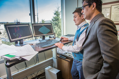 Prof. Rajive Ganguli, right, works with mineral engineering graduate student Erdenebaatar Dondov to study software models of mining design in his Duckering Building office. Ganguli is helping Dondov and the government in his home country of Mongolia to establish a school of mining engineering there to educate locals to help develop the country's mineral resources.  Filename: AAR-13-3842-13.jpg