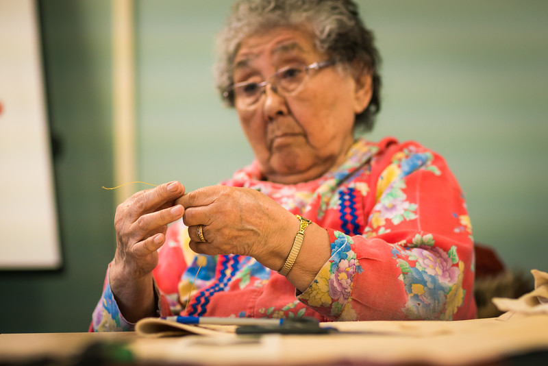 "Local elder Eula David leads an evening beading class at UAF's Kuskokwim Campus in Bethel.  <div class=""ss-paypal-button"">Filename: AAR-16-4859-560.jpg</div><div class=""ss-paypal-button-end""></div>"