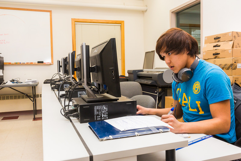 """Gilbert Snell, a student at UAF's Bristol Bay Campus in Dillingham, catches up on some math homework in the school's computer lab.  <div class=""""ss-paypal-button"""">Filename: AAR-16-4860-213.jpg</div><div class=""""ss-paypal-button-end""""></div>"""
