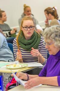 Students in Associate Professor Dani Sheppard's Psychology 335 class, Brain and Behavior, break into groups to discuss questions on the final exam Dec. 17 in the Gruening Building.  Filename: AAR-14-4414-158.jpg